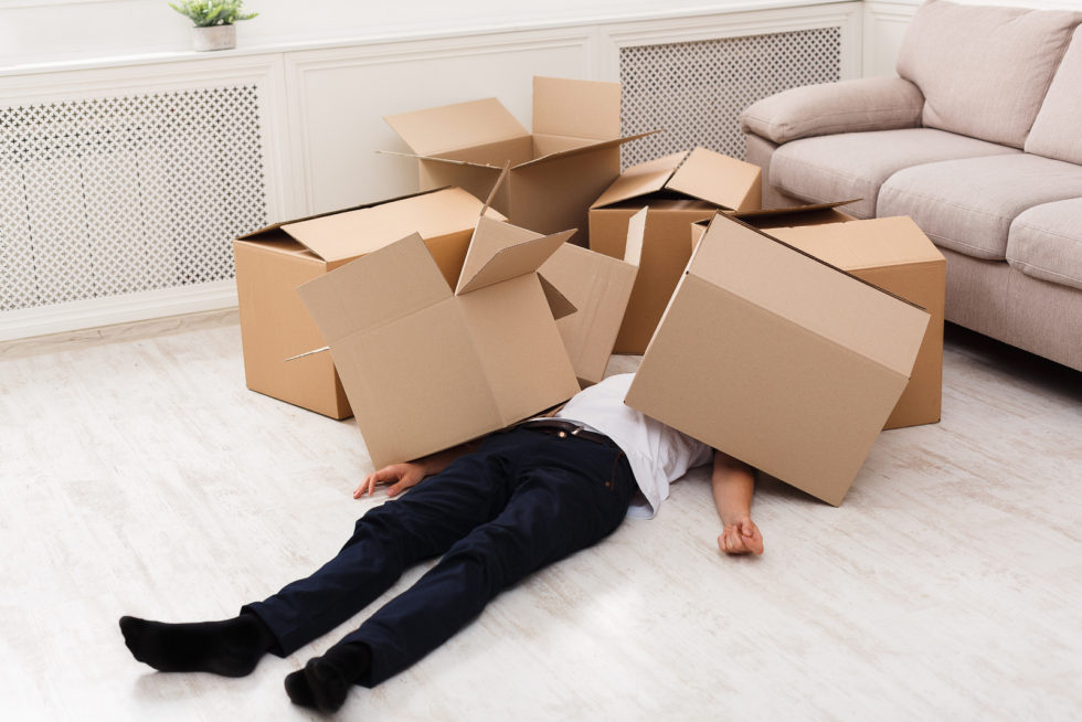 Man lying with boxes